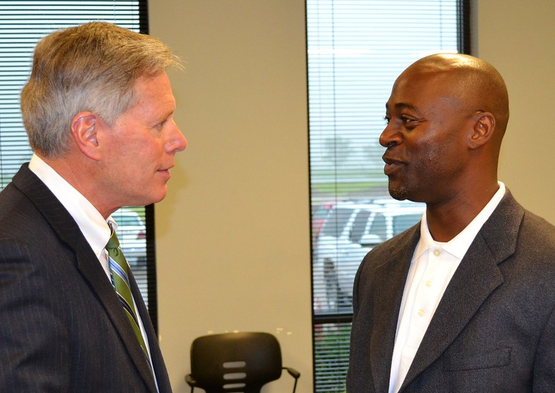 President LaForge speaks with Mississippi Valley State University Senior Graphic Designer John McCall.