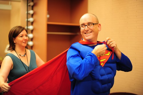 Jolie Guillebeau helps Superman (aka Darren Rowse) prepare for his entrance at WDS 2013