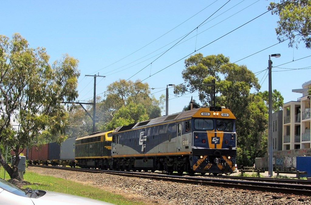Locos G515+S303 lead their train through Melbourne's South Eastern suburbs bound for the 'Australian Paper' mill at Maryvale, Victoria by Adam Serena