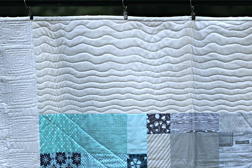 Free motioned wavy lines on the Boxed In quilt