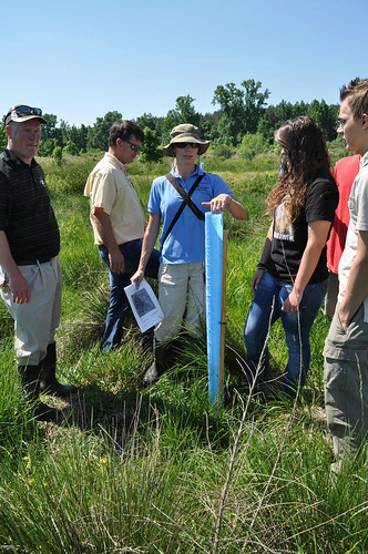 Sudie Daves-Thomas, a wildlife biologist with NRCS, teaches students about the different types of trees they have planted on the wetland site. NRCS photo.