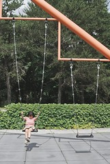 outdoor structure(0.0), jumping(0.0), trampolining--equipment and supplies(0.0), roof(0.0), sports equipment(0.0), mast(0.0), net(0.0), trampoline(0.0), outdoor play equipment(1.0), swing(1.0), playground(1.0),
