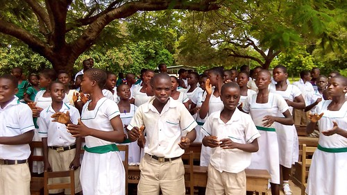A section of Oku Junior High School pupils singing and clapping