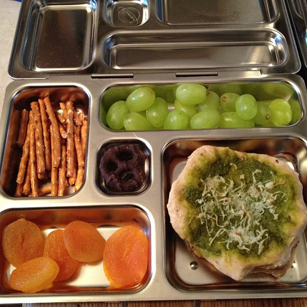 Reno's Lunch: mini pesto and cheese pizzas, dried apricots, pretzels, grapes, choc cov pretzel. #vegan