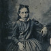 Small photo of Tin type portrait of an intense young girl