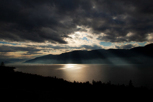 trees sky canada mountains water sunshine clouds forest reflections landscape reflecting bc okanagan lakes scenic silhouettes hills glowing rays crepuscular