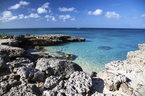ocean blue sea sky cloud color beach water coral rock clouds sailboat canon landscape outdoors eos coast scenic azure aruba beaches sail caribbean caribbeansea 5dmarkii canon5dmarkii