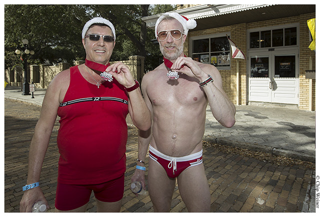 Tony Taroski and Rob Akins modeled their medals and Speedo's after the Santa run