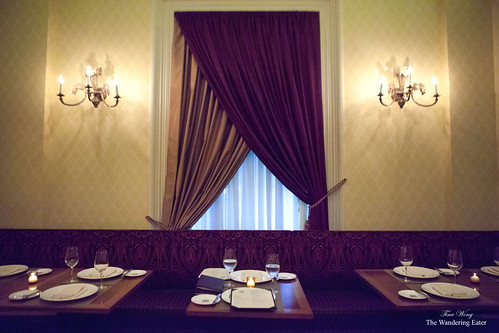 Beautiful drapes by the banquette
