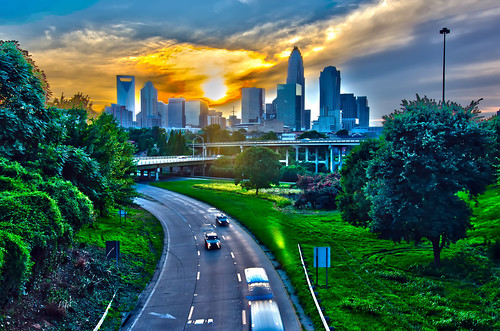 sun setting over charlotte north carolina a major metropolitan city by DigiDreamGrafix.com