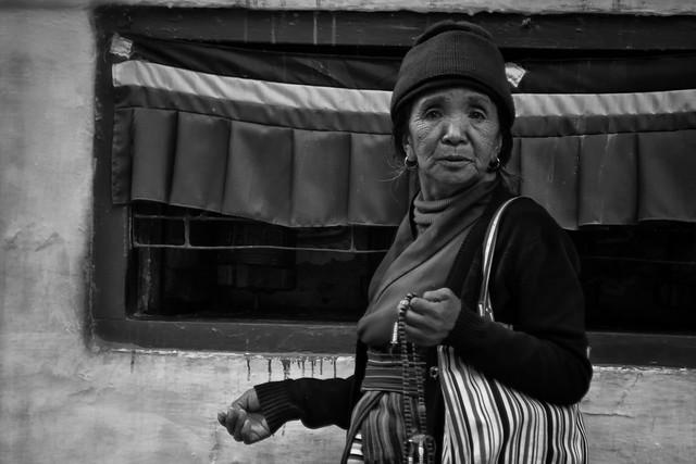 A Tibetan Lady Praying At The Bodhnath, Kathmandu