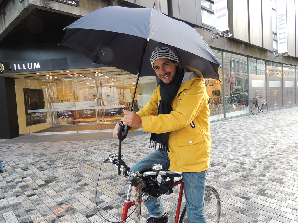 Copenhagen Rain Man riding in the rain