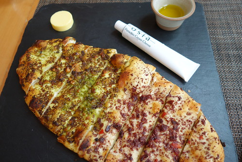 Osia's Stone Hearth Flat Bread with Truffled Kalamata Olive & Macadamia Pesto (half & half)
