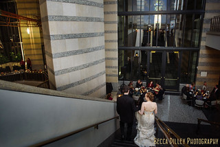 Walking down stairs to St Paul History Center wedding reception