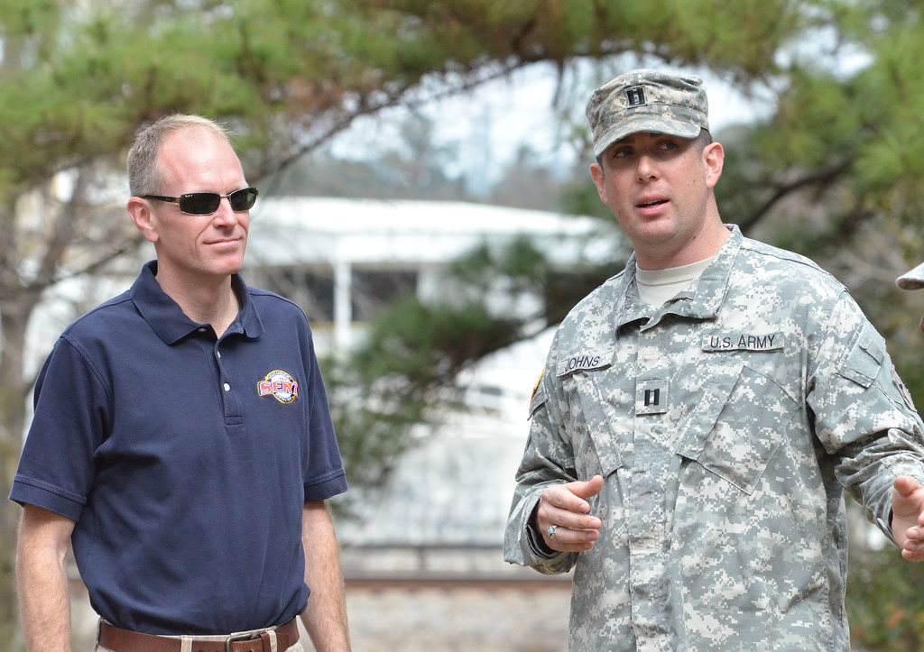 Bryan Koon, Director of Florida Division of Emergency Management and Captain Christopher Johns, commander of Company A, 779th Engineer Battalion, Forward Support Company.