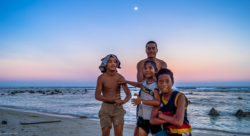 world travel sunset people moon beach boys rock kids swim island coast pacific dusk south country third ethnic smallest micronesia nauru anibare