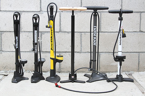 Floor pumps for bicycles