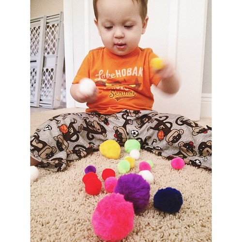 I taught Will about colors with pompoms this morning. We didn't do much color sorting, but he loved the texture and the bright colors! #pictapgo_app #babies #teaching