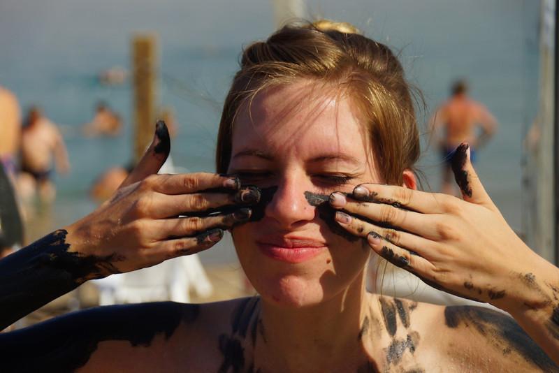 Getting muddy in the Dead Sea.