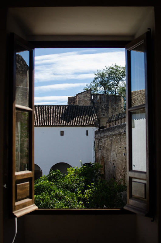 A view through a window at Alcázar de los Reyes Cristianos in Córdoba, Spain.