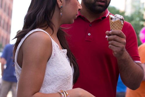 Man Offering Ice Cream Cone to Woman 2013 Festival of the Arts Grand Rapids  June 07, 2013 6