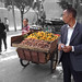 Selling Mandarin Orange & Dried Persimmons in Guilin by Poon Tse Wan