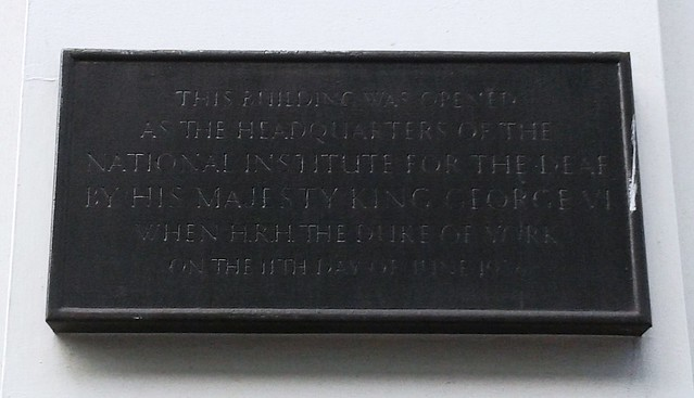 National Institute for the Deaf bronze plaque - This building was opened as the headquarters of the National Institute for the Deaf by His Majesty King George VI when HRH the Duke of York on the 11th day of June 1936.