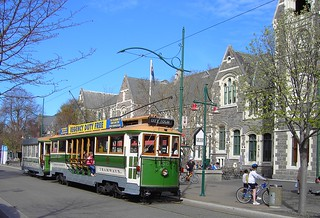 Christchurch. The old trams in Christchurch New Zealand outside the Gothic Arts Centre which was the University of Canterbury until 1973.