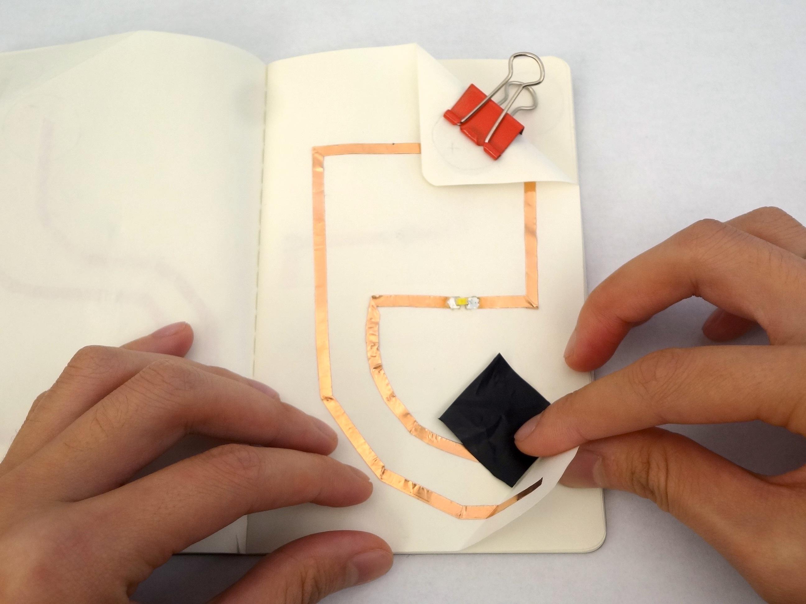 inserting pressure sensor paper