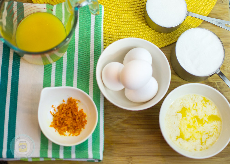 Melted butter, 4 white eggs, milk in measuring cups and other ingredients ready for prep