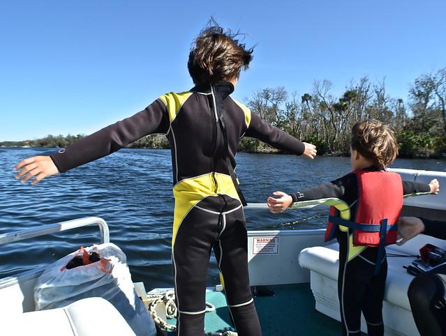 kid having fun at nature coast manatee tour