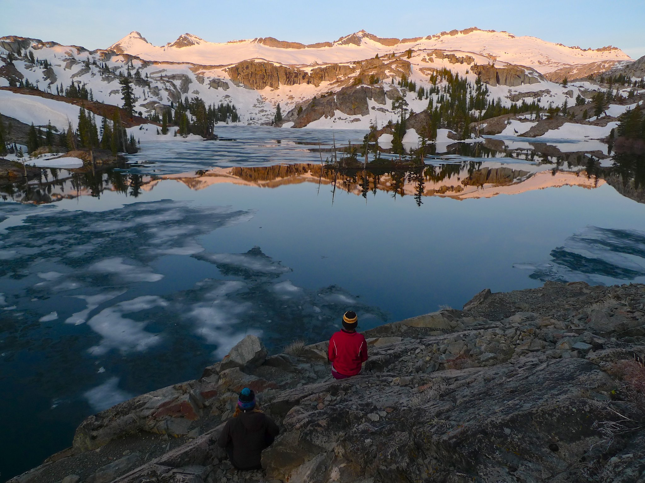 Allie and Miranda enjoy the alpenglow on the Crystal Range at Heather Lake