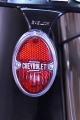 automotive exterior(0.0), wheel(0.0), rim(0.0), steering wheel(0.0), grille(0.0), bumper(0.0), spoke(0.0), automobile(1.0), automotive tail & brake light(1.0), automotive lighting(1.0), red(1.0), automotive design(1.0), font(1.0),