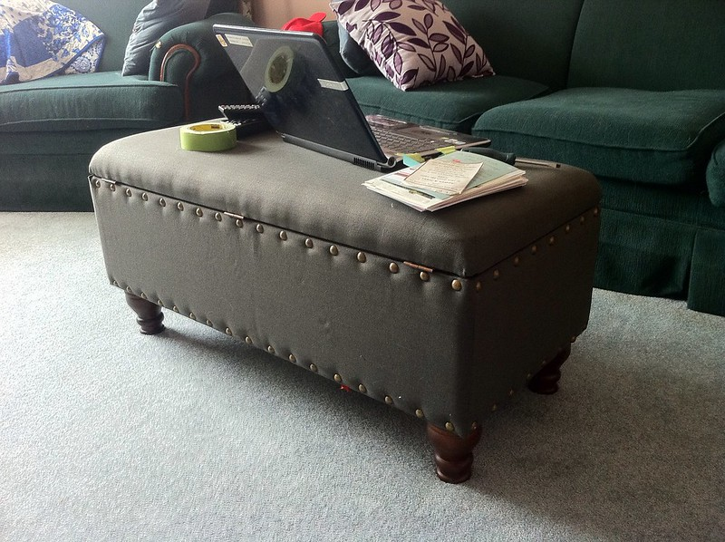 grey upholstered storage ottoman bench