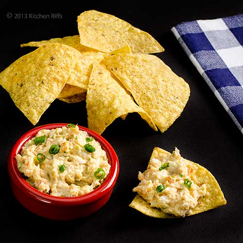 Shrimp Toast Dip in red ramekin with tortilla chips