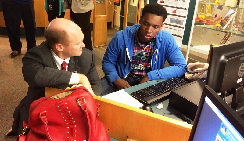Senator Coons works on a college application with student Tah-Jay McLaughlin during a visit to Mt. Pleasant High School on November 15, 2013 for College Application Month.