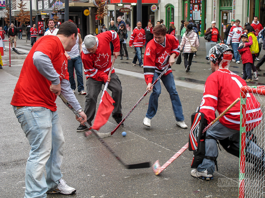 Ball hockey breaks out in the middle of Granville Street.