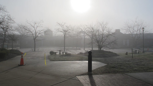 Courtyard in sun and fog by Coyoty