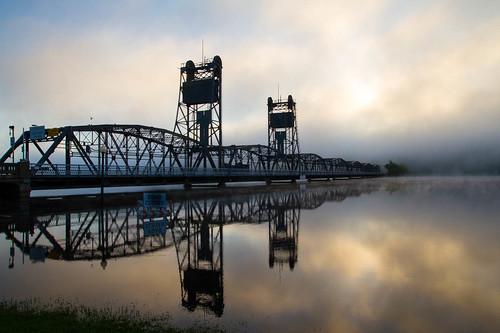weather fog reflections bridges places transportation stillwater sunrises stcroixriver liftbridge sunevents