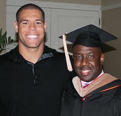 Auburn football player and senior marketing student C.J. Uzomah, left, congratulates his dad, Xavier, who earned his Executive MBA in May.