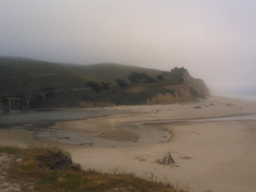 San Gregorio River in the fog, cliffs, sand estuary, San Gregorio State Beach, Pescadero, California, USA by Wonderlane