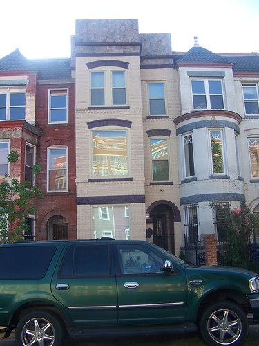 A recently constructed facade of stone, on an 1880s/1890s Victorian brick rowhouse, 800 block of H Street NEan 1890s