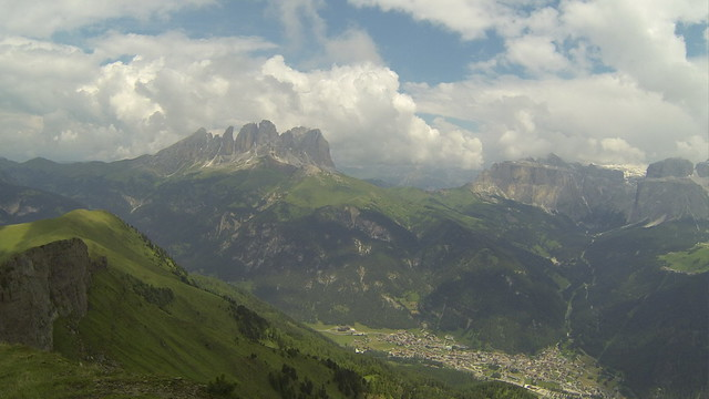 Dolomites summits all around and down below lies the wonderful village of Canazei