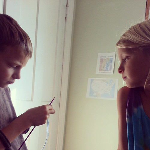 Precious. Little sis is teaching her brothers to knit.