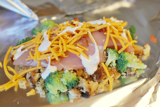 Cheesy Chicken Hobo Packs - stuffing, chicken, broccoli, bacon, and cheese all layered and cooked in foil packets. Easiest dinner ever!