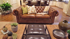 furniture(1.0), wood(1.0), loveseat(1.0), room(1.0), table(1.0), living room(1.0), interior design(1.0), couch(1.0), studio couch(1.0), hardwood(1.0),