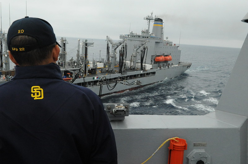 Capt. John Menoni, executive officer of USS San Diego (LPD 22), observes an underway replenishment