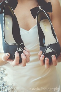 Bride showing bow heels and matching bow nail art