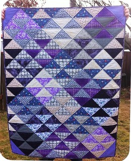 Half square triangle quilt in purple and grey
