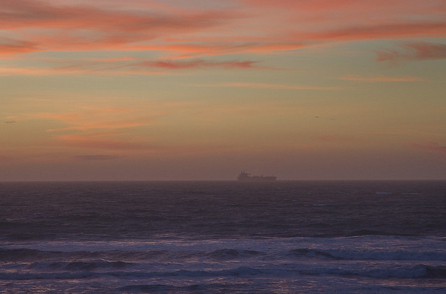 Container ship on the horizon at sunset POV Ocean Beach, San Francisco (2014)